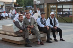 Four amigos: Kurdish men lounge on a bench in the center of Diyarbakir, Turkey's old city. (2010)