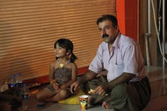 Quality time: A man and his daughter enjoy a late-night snack on a curb outside the citadel in Erbil, Iraq.