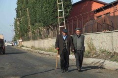 Kars constitutional: Two men walk toward a market on the outskirts of Kars, Turkey. (2010)