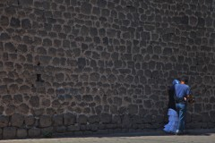 At the wall: A young Kurdish couple share an embrace in a deserted area of Diyarbakir, Turkey, along the old city wall. (2010)