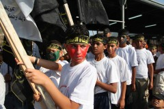 In training: Boys carrying flags of Palestinian Islamic Jihad line up and wait for their cue to march to the stage at a graduation ceremony and rally for PIJ youth. (2010)