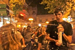 Raaaaah! Israeli youths celebrate Israeli Independence Day by spraying each other with foam on Ben Yehuda street in downtown Jerusalem. (2010)