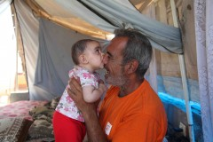 Nom nom: Baby Leyali teethes on the nose of her father, Kemal Awaja. The Awaja family has lived in a group of makeshift tents since their house was destroyed by Israeli tanks during Operation Cast Lead in January 2009. (2010)