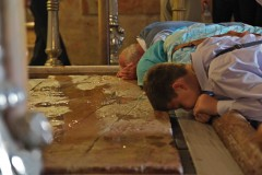 Pilgrims pray at the Unction Stone, where Jesus is said to have been prepared for burial, in the Church of the Holy Sepulchre in Jerusalem's Old City. (2010)