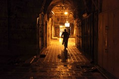 Biking empty streets: A boy rides his bike through Nablus's old city after the shops have closed. (2010)