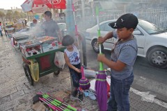 Two Palestinian children prepare cleaning wares for sale outside the Damascus Gate of Jerusalem's Old City. (2010)