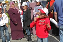 Tasty treat: A girl enjoys a popsicle at the 5th anniversary protest against settlement expansion in the West Bank town of Bil'in. (2010)