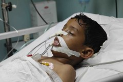 Casualty of war: A young boy suffering from brain damage lies in a coma at the Shifa Hospital in Gaza City. (2010)