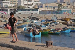 Port halfpipe: A boy dances on a fishing pier in Gaza City. (2010)