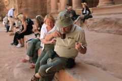 French tourist in Petra: A tourist sips an espresso outside the Great Temple in Petra, Jordan. (2010)
