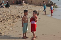 Flirt: A bubbly young Palestinian girl teases a very serious young Palestinian boy on the beach in Gaza City. (2010)