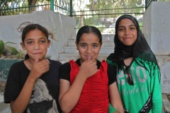 Thinking about it: Three Palestinian girls timidly pose for a photo in a Gaza City park. (2010)