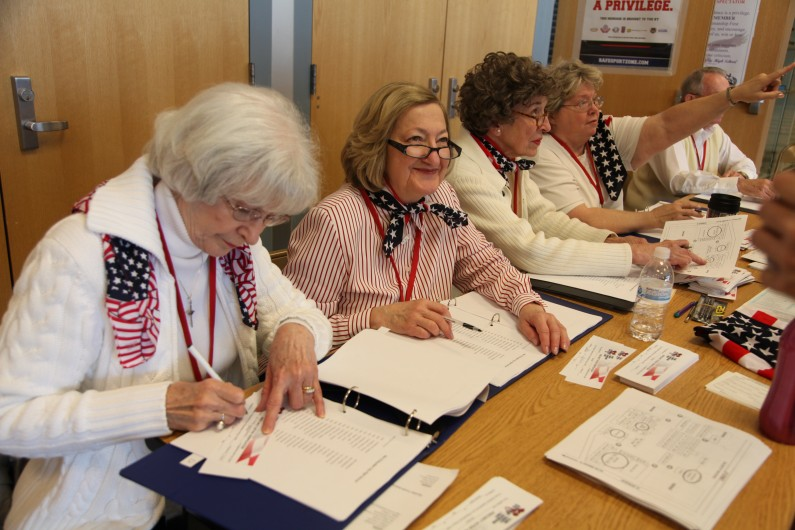 Volunteers sign voters into the state GOP caucus at Boulder City High School in Boulder City, N.V. (2012)