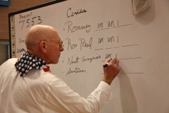 A GOP caucus volunteer tallies the precinct votes in Boulder City, N.V. (2012)