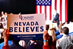 A Romney fan holds a sign as Romney addresses supporters in his Nevada victory speech, after the state GOP caucuses. (2012)