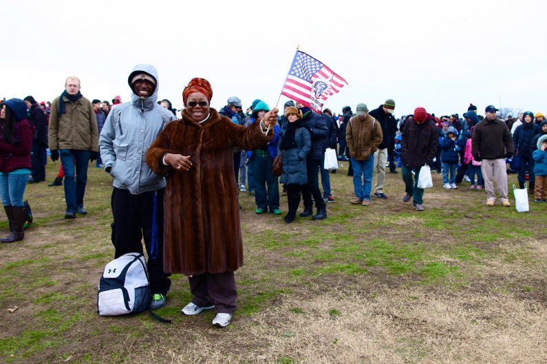 Lynette Lynn-Horton and her son, Jordan Coleman, brave the cold to stand on the National Mall for Barack Obama's second inaugural address. (2013)