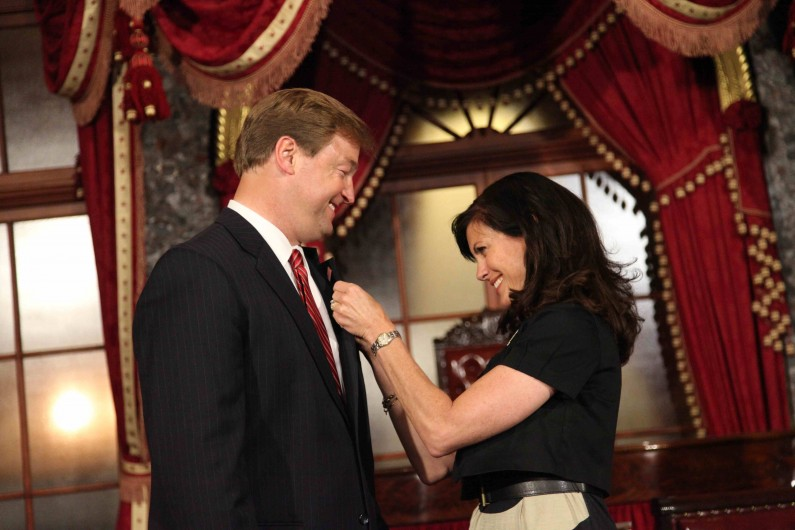 Sen. Dean Heller's wife, Lynne, affixes his senator's pin to his lapel, just before Heller is sworn in to replace outgoing Sen. John Ensign. (2011)