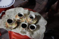 evening coffee in demitasse cups spills on the serving tray (2010)